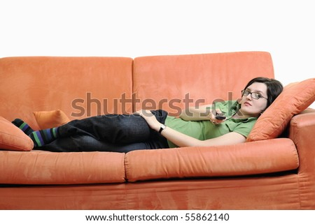 happy young woman relax on orange sofa isolated on white in studio