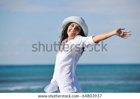 happy young woman relax onbeautiful  beach at morning - stock photo