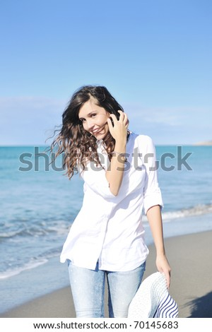 happy young woman relax onbeautiful  beach at morning