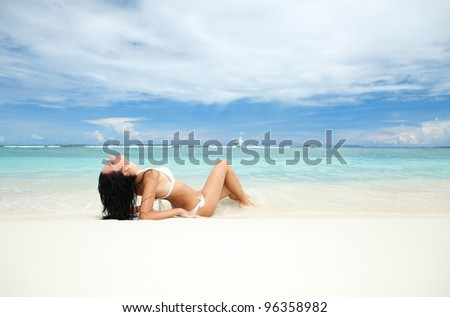 Happy young woman rest on the beach - stock photo