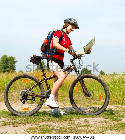 Happy Young Woman riding bicycle outside.Bike. Healthy Lifestyle. - stock photo
