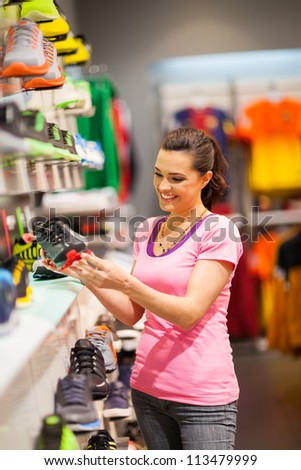 happy young woman shopping for sports shoes