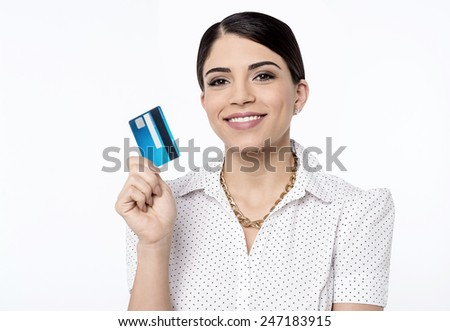 Happy young woman showing her cash card