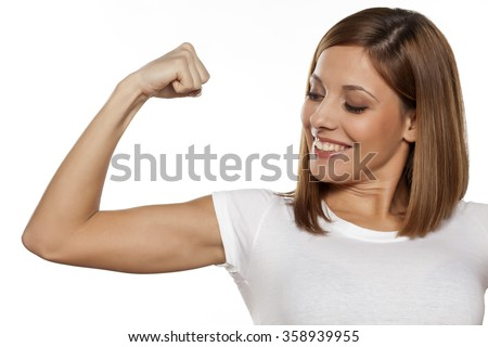 happy young woman showing her pretty hand - stock photo
