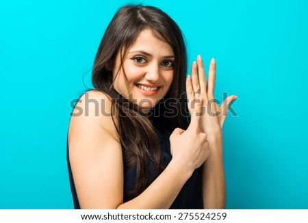 happy young woman showing on the a wedding ring - stock photo
