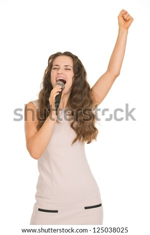 Happy young woman singing with microphone