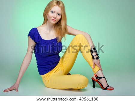 happy young woman sitting on floor - stock photo