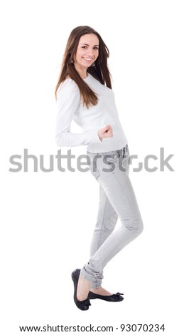 Happy young woman standing full length isolated on white background - stock photo