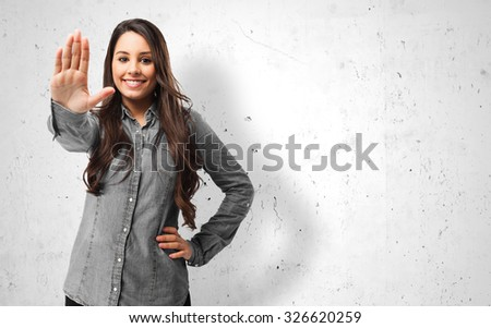 happy young woman stop gesture - stock photo