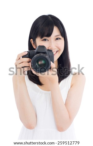 happy young woman taking photo with digital single-lens reflex camera, isolated on white background - stock photo
