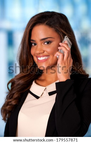 Happy young woman talking on her cell phone