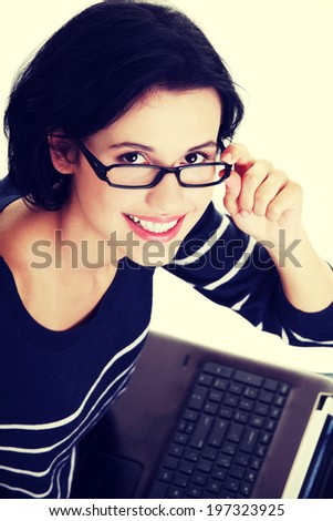Happy young woman using her laptop. - stock photo