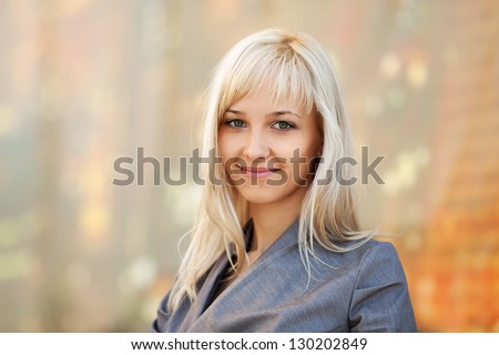 Happy young woman walking on a city street - stock photo