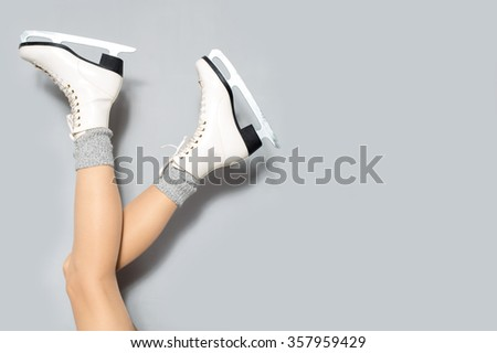 Happy young woman wearing skates enjoy her winter holiday - stock photo