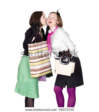 Happy, young woman whispering a secret to a friend at shopping time. Isolated on white. - stock photo