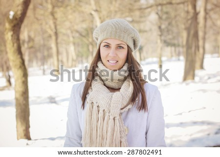 Happy Young Woman Wintertime in the park.Caucasian female winter portrait outdoor. - stock photo