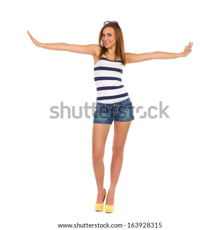 Happy young woman with arms outstretched. Full length studio shot isolated on white. - stock photo