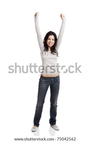 Happy young woman with arms up, isolated against a white background - stock photo