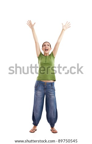 Happy young woman with arms up, isolated against a white background
