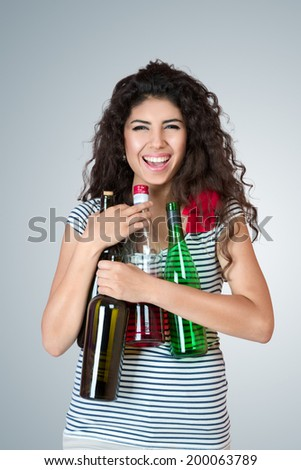 Happy young woman with bottle of wine - stock photo