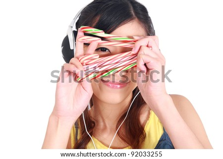 happy young woman with Candy cane isolated on white - stock photo