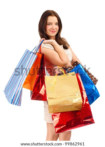 Happy young woman with colorful shopping bags. Isolated on white background