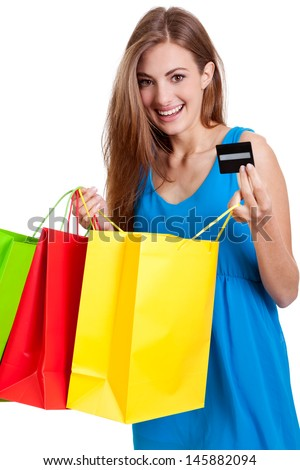 happy young woman with colorful shopping bags visa credit card isolated
