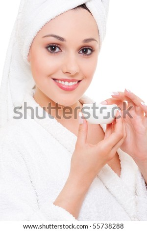 happy young woman with face cream after shower - stock photo