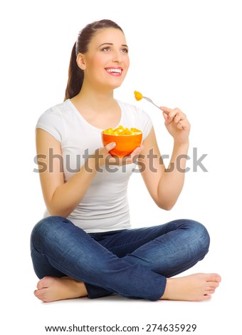 Happy young woman with fruit salad isolated - stock photo