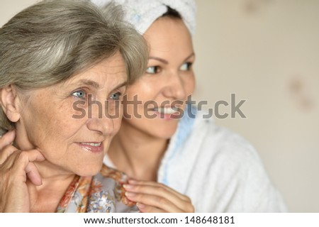 happy young woman with her elder mother at home