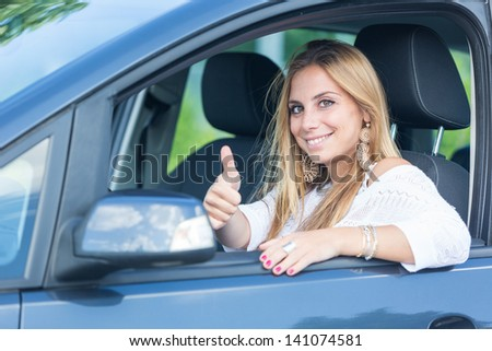 Happy Young Woman with Her New Car - stock photo
