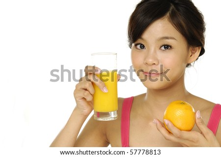 Happy young woman with juice of tropical fruit - stock photo