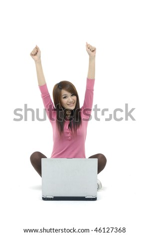 Happy young woman with laptop - stock photo