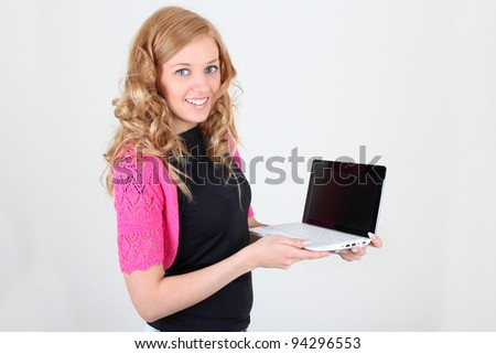 Happy young woman with laptop over white