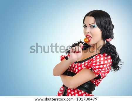 Happy young woman with lollipop candy - stock photo