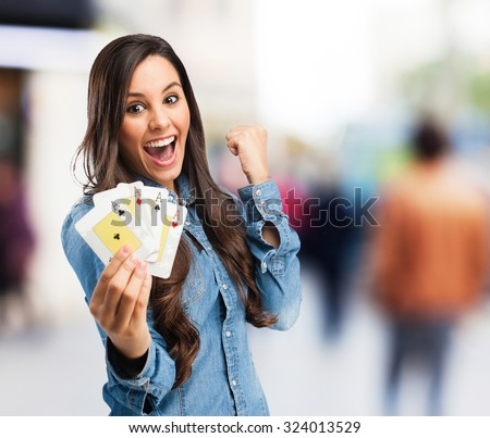 happy young woman with poker cards - stock photo
