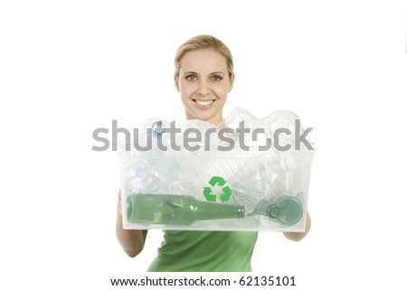 Happy young woman with recycling bin