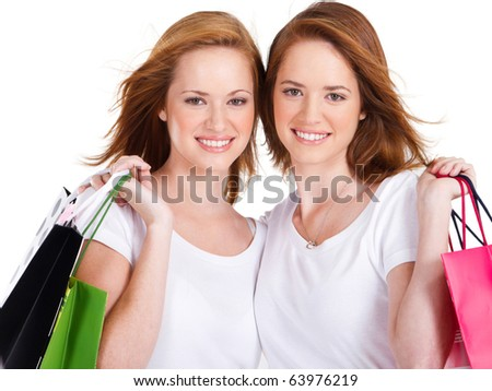 happy young woman with shopping bags isolated on white