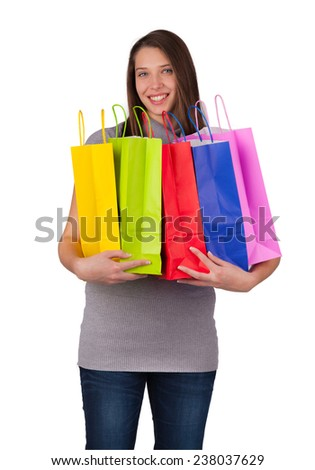 Happy young woman with shopping bags, isolated on white background - stock photo