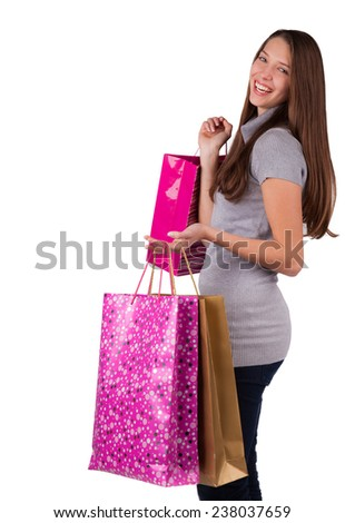 Happy young woman with shopping bags, isolated on white background