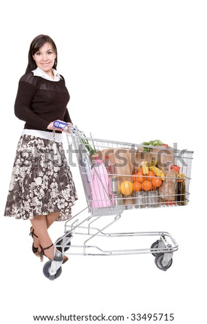 happy young woman with shopping cart - stock photo