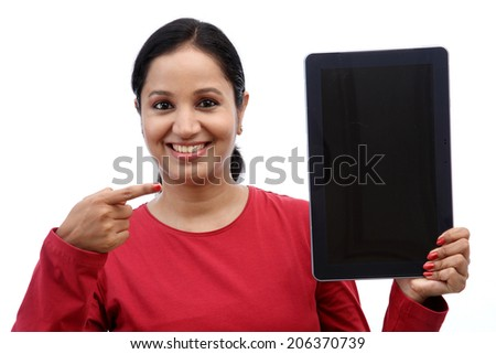 Happy young woman with tablet computer against white background - stock photo