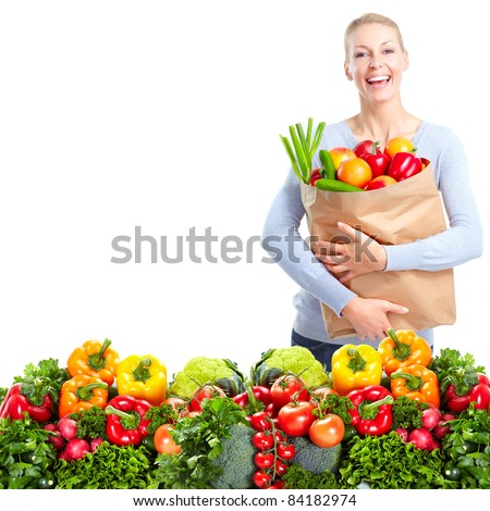 Happy young woman with vegetables. Isolated over white. - stock photo