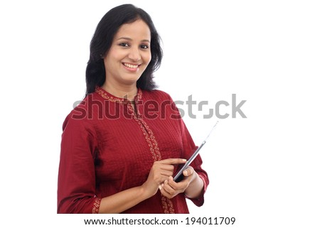 Happy young woman working with tablet computer against white background - stock photo