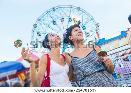 Happy Young Women at Luna Park - stock photo