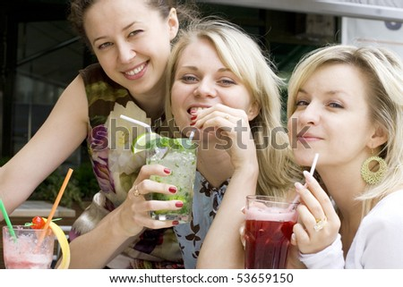 Happy Young Women At The Cafe