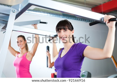 Happy, young women doing strength or sports training in gym for a better fitness - stock photo