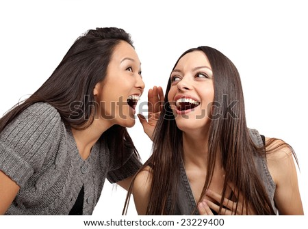 Happy young women sharing a laugh
