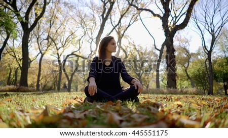 happy young women spending time in autumn park outdoors at sunset. attractive female lifestyle portrait - stock photo
