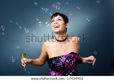Happy young women with a glass of champagne. - stock photo